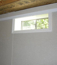Basement windows brightening a refinished space