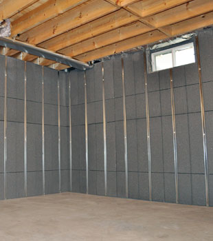 Basement To Beautiful™ panels installed on a basement wall that's ready to be finished.