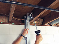 Straightening a foundation wall with the PowerBrace™ i-beam system in a Saint-Jean-sur-Richelieu home.